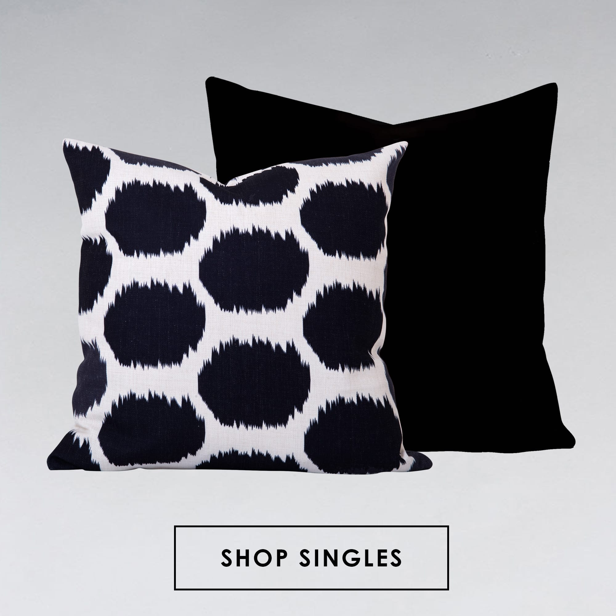Arzu Black Ikat Cushion and Georgia Plain Black Cushion
